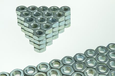 large size: Metallic large size bolts pattern and background Stock Photo
