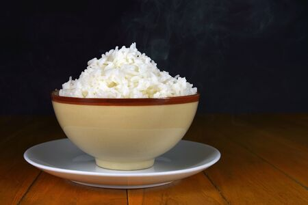 steamy: Glass bowl of cooked rice