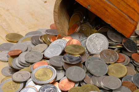 accumulate: Heap of Thai Baht coins on a wooden table Stock Photo
