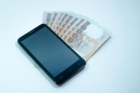 notecase: Mobile phone and money Stock Photo