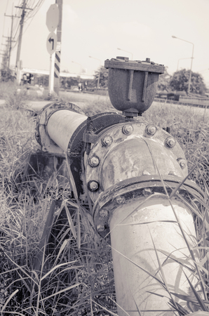main gate: Old gate valve connects to water supply with metal pipe,vintage style Stock Photo