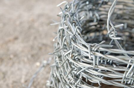 cattle wire: coil of barbed wire on the counter in the store . building materials store in the open air
