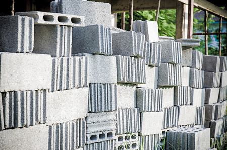 concrete blocks: Stacks of interlocking stones for installing driveway landscaping Stock Photo