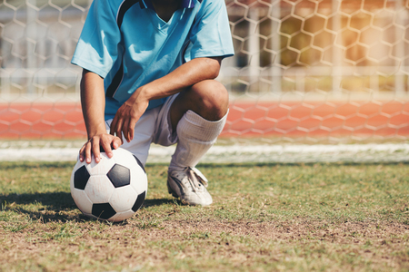 soccer football player in blue team concept holding soccer ball Stockfoto