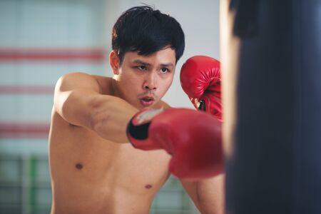 Boxer boxing in punching bag