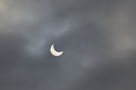 Solar eclipse, half phase, January 4, 2011, Bucharest, Romania Stock Photo - 8544003