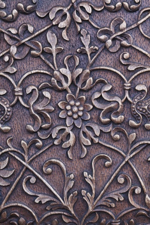 a traditional sculpture on an old wooden door Stock Photo - 8653832