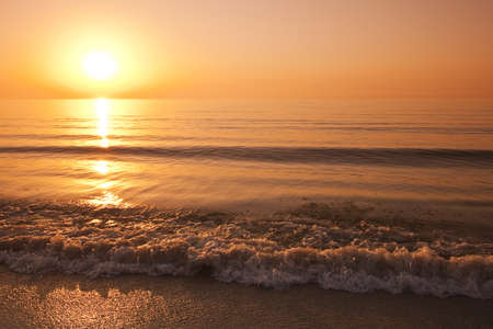 golden reflection of the sun on the beach