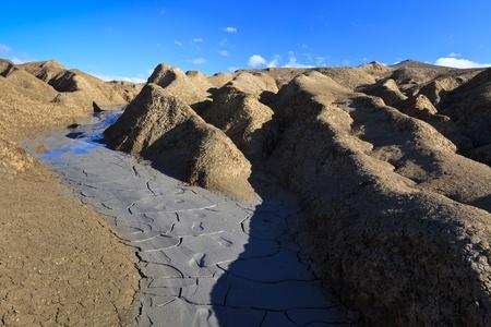 bu: Strange landscape produced bu active mud volcanoes. Location: Buzau Romania