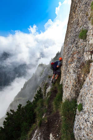 tourists on an aerial trail in Bucegi Mountains, Romania photo
