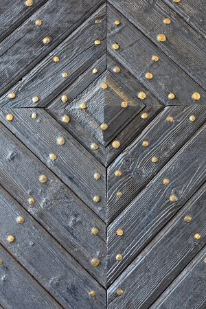 a detail on an old wooden door