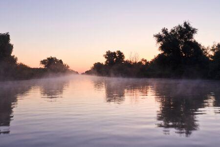 danube delta: reflection of trees on a blue lake, Danube Delta, Romania