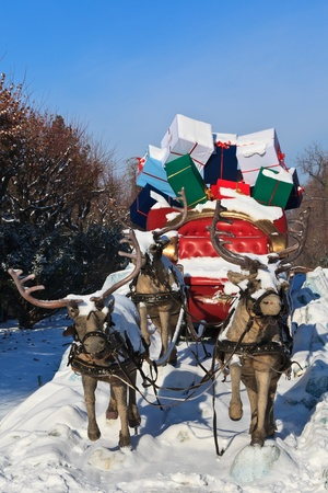 a carriage pulled by four reindeer with gifts photo