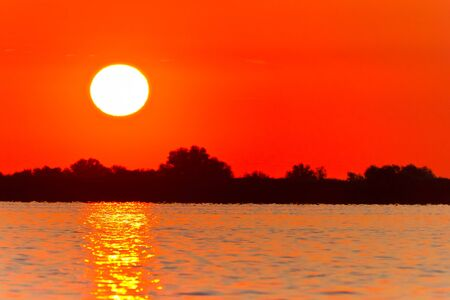 a beautiful sunrise on the lake. Danube Delta, Romania photo