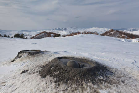 mud and snow: Mud Volcanoes in winter  Location  Buzau Romania