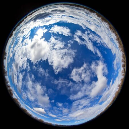 fisheye lens image of blue sky with clouds