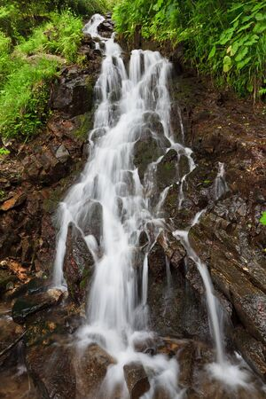 a beautiful waterfall on a mountain slope Stock Photo - 13360790