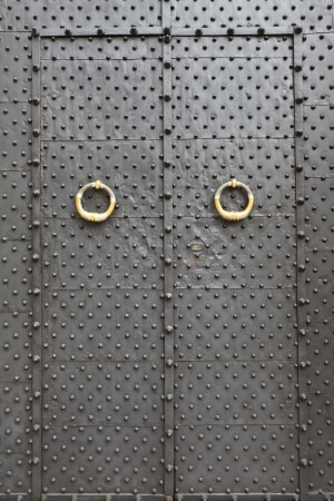 medieval metal door in the Genoa, Italy photo