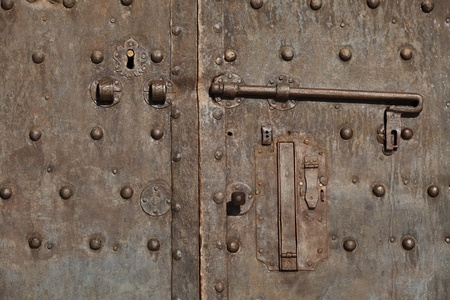 medieval metal door in the Pisa, Italy photo