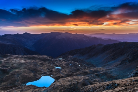 before sunrise in Fagaras Mountains. Galbena Lake in Southern Carpathians, Romania  Stock Photo