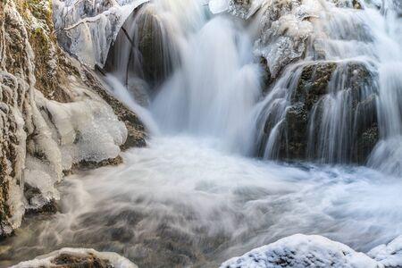 a small waterfall on a mountain creek photo