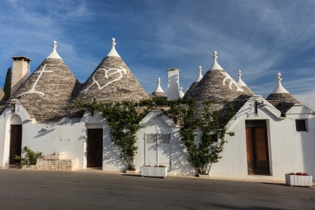 Trulli houses with painted symbols on the conical roofs in Alberobello Italy Puglia & Trulli Houses With Painted Symbols On The Conical Roofs In ... memphite.com