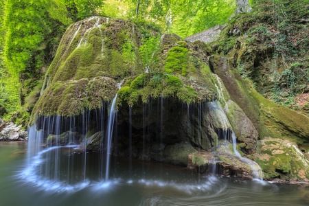 Waterfall Bigar. Located at the intersection with the parallel 45 in Romania.  Stock Photo