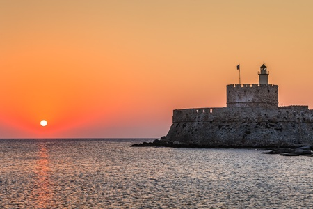 Agios Nikolaos fortress on the Mandraki harbour of Rhodes, Greece  photo