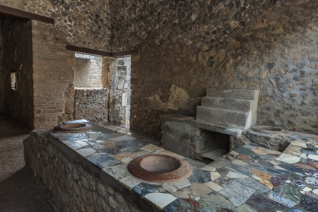 Ancient Pompeii - Thermopolium of Asellina with old food serving counter Stock Photo