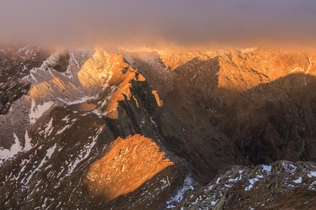 fagaras: sunrise in Caltun lake. Fagaras Mountains, Romania Stock Photo