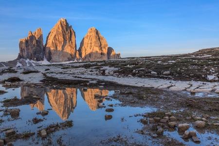 dolomite: Tre cime di Lavaredo reflected from a lake, Dolomite Alps, Italy