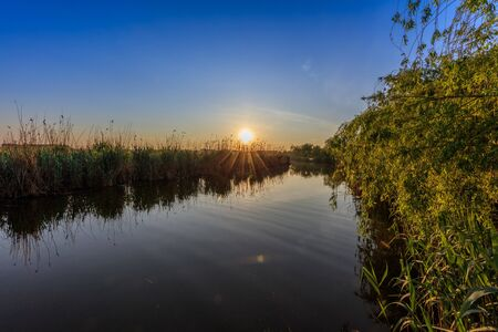 danube delta: beautiful sunrise in the Danube Delta , Romania Stock Photo