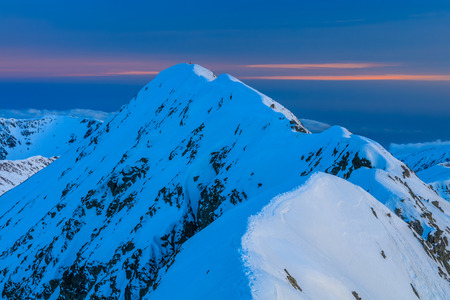 The Moldoveanu Peak in winter. Fagaras Mountains, Romania Stock Photo
