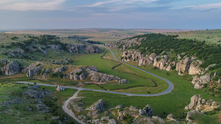 mountain landscape with some of the oldest limestone rock formations in Europe in Dobrogea Gorges (Cheile Dobrogei) Romania