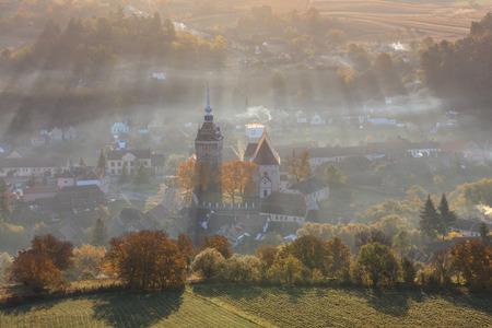 Saschiz fortified church in sunrise. Transylvania, Romania