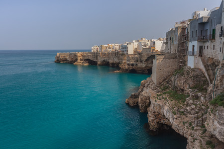 Houses on the rocks of the coast of Polignano a mare at the Mediterranean in Italy