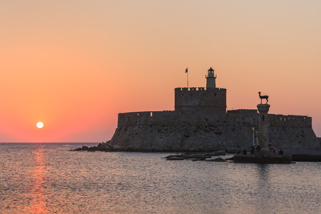 Agios Nikolaos fortress on the Mandraki harbour of Rhodes, Greece Foto de archivo