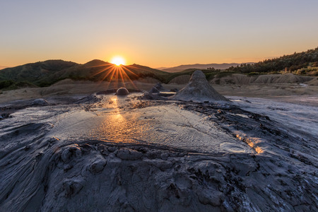 sunset in Mud Volcanoes. Buzau county, Romania