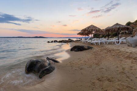 sunset on the beach near Ouranoupolis city. Halkidiki, Greece Stok Fotoğraf