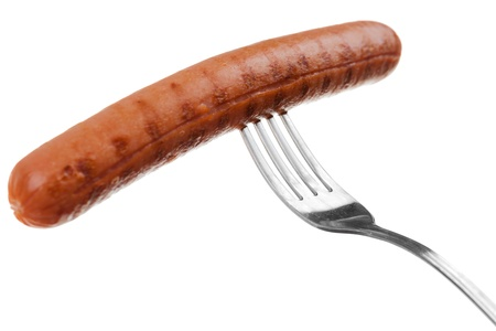 a delicious sausage on a fork over white photo