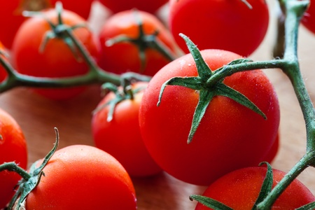 Little tomatoes on a wooden chopping board Stock Photo - 18170377