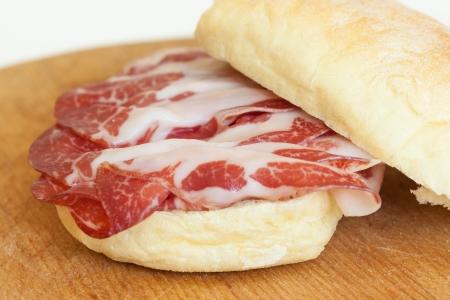 a delicious sandwich filled with italian salami (coppa di parma) Stock Photo