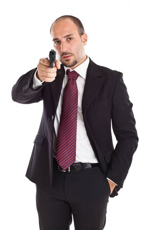 a businessman with a gun aiming at you!