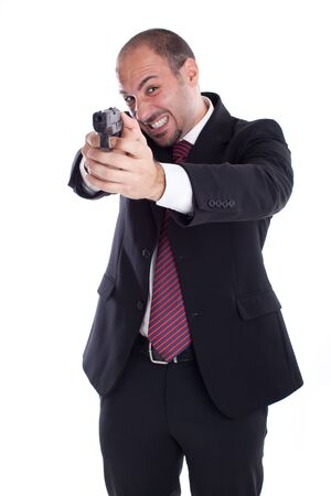 a businessman with a gun aiming at you! photo