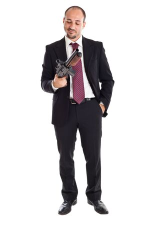 a businessman standing and holding a shotgun photo