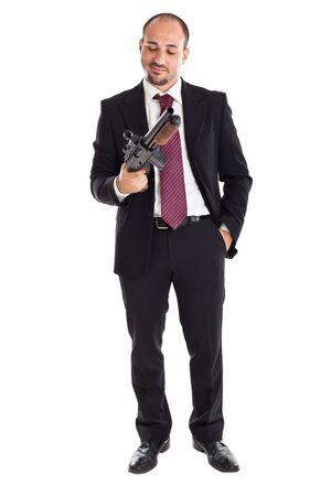 a businessman standing and holding a shotgun photo