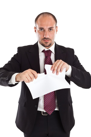 a classy businessman tearing some paper sheets photo