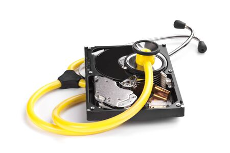 computer repairing: An hard disk with a sthetoscope isolated on white background
