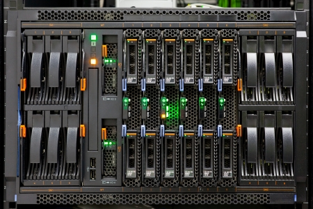 Network Server Rack Panel with hard disks in a data center. Stock Photo