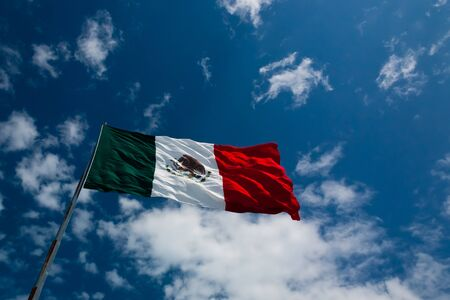 The Flag of Mexico seen from below on a rich blue sky Stock Photo